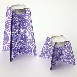 Group Of Purple Swirl Tea Light Holders With Candle